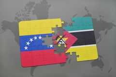 Puzzle with the national flag of venezuela and mozambique on a world map. Background. 3D illustration Stock Photos