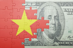 Puzzle with the national flag of vietnam and dollar banknote Royalty Free Stock Photos