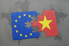 Puzzle with the national flag of vietnam and european union on a world map. Background stock photos