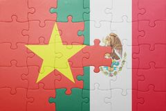 Puzzle with the national flag of vietnam and mexico. Concept stock images