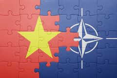 Puzzle with the national flag of vietnam and nato. Concept royalty free stock images