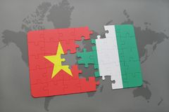 Puzzle with the national flag of vietnam and nigeria on a world map. Background. 3D illustration royalty free stock photo