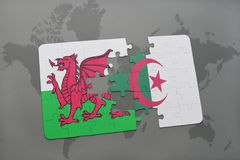 Puzzle with the national flag of wales and algeria on a world map Stock Photo