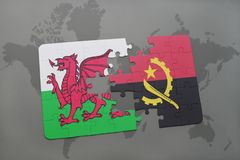Puzzle with the national flag of wales and angola on a world map Royalty Free Stock Photography