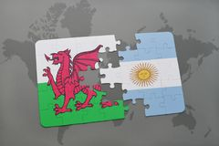 Puzzle with the national flag of wales and argentina on a world map. Background. 3D illustration Stock Photography