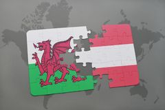 Puzzle with the national flag of wales and austria on a world map background. 3D illustration Stock Images