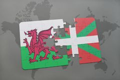 Puzzle with the national flag of wales and basque country on a world map background. 3D illustration Stock Images