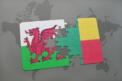 Puzzle with the national flag of wales and benin on a world map Royalty Free Stock Photography