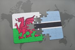 Puzzle with the national flag of wales and botswana on a world map Royalty Free Stock Photos