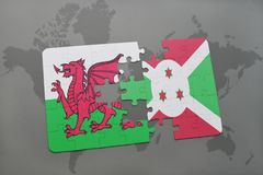 Puzzle with the national flag of wales and burundi on a world map Royalty Free Stock Photography