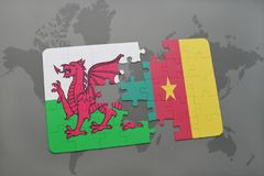 Puzzle with the national flag of wales and cameroon on a world map Stock Photos