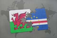 Puzzle with the national flag of wales and cape verde on a world map Stock Images