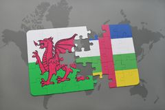 Puzzle with the national flag of wales and central african republic on a world map Stock Image