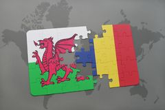 Puzzle with the national flag of wales and chad on a world map Stock Photography