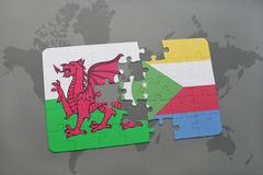 Puzzle with the national flag of wales and comoros on a world map Stock Photo