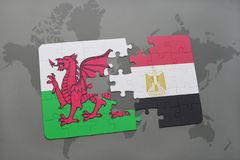 Puzzle with the national flag of wales and egypt on a world map. Background. 3D illustration Stock Photo