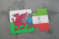 Puzzle with the national flag of wales and equatorial guinea on a world map. Background. 3D illustration Stock Photo