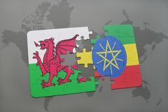 Puzzle with the national flag of wales and ethiopia on a world map. Background. 3D illustration Stock Image