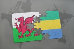 Puzzle with the national flag of wales and gabon on a world map. Background. 3D illustration Stock Images