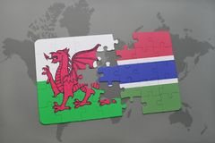 Puzzle with the national flag of wales and gambia on a world map. Background. 3D illustration Royalty Free Stock Photo