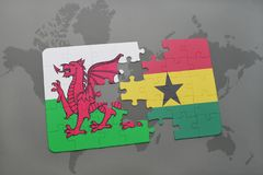 Puzzle with the national flag of wales and ghana on a world map. Background. 3D illustration Stock Photos