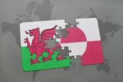 Puzzle with the national flag of wales and greenland on a world map. Background. 3D illustration Royalty Free Stock Images