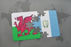 Puzzle with the national flag of wales and guatemala on a world map. Background. 3D illustration Royalty Free Stock Photo
