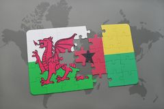 Puzzle with the national flag of wales and guinea bissau on a world map. Background. 3D illustration Royalty Free Stock Photography