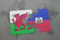 Puzzle with the national flag of wales and haiti on a world map. Background. 3D illustration Royalty Free Stock Photo