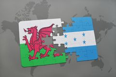 Puzzle with the national flag of wales and honduras on a world map. Background. 3D illustration Royalty Free Stock Image