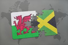 Puzzle with the national flag of wales and jamaica on a world map. Background. 3D illustration Royalty Free Stock Photo
