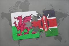 Puzzle with the national flag of wales and kenya on a world map Royalty Free Stock Images