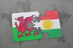 Puzzle with the national flag of wales and kurdistan on a world map. Background. 3D illustration Stock Photo