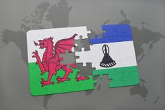 Puzzle with the national flag of wales and lesotho on a world map Royalty Free Stock Photo