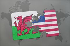 Puzzle with the national flag of wales and liberia on a world map Stock Photo