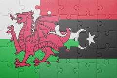 puzzle with the national flag of wales and libya Royalty Free Stock Photography