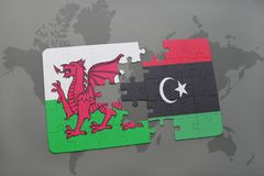Puzzle with the national flag of wales and libya on a world map Royalty Free Stock Image