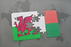 Puzzle with the national flag of wales and madagascar on a world map Stock Images