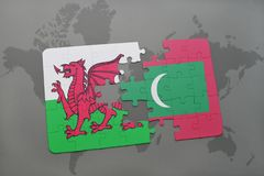 Puzzle with the national flag of wales and maldives on a world map. Background. 3D illustration Stock Image