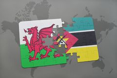 Puzzle with the national flag of wales and mozambique on a world map Stock Photos
