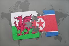 Puzzle with the national flag of wales and north korea on a world map. Background. 3D illustration Royalty Free Stock Photography