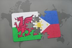 Puzzle with the national flag of wales and philippines on a world map. Background. 3D illustration Stock Images