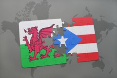 Puzzle with the national flag of wales and puerto rico on a world map. Background. 3D illustration Stock Photos