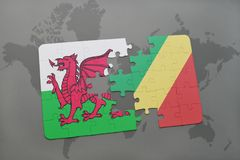 Puzzle with the national flag of wales and republic of the congo on a world map Stock Photo