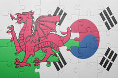 Puzzle with the national flag of wales and south korea. Concept stock photos