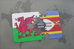 Puzzle with the national flag of wales and swaziland on a world map Royalty Free Stock Photos