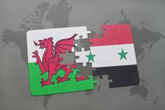 Puzzle with the national flag of wales and syria on a world map. Background. 3D illustration Stock Images