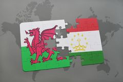 Puzzle with the national flag of wales and tajikistan on a world map. Background. 3D illustration Stock Photo