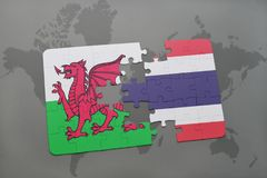 Puzzle with the national flag of wales and thailand on a world map. Background. 3D illustration Stock Image