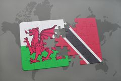 Puzzle with the national flag of wales and trinidad and tobago on a world map. Background. 3D illustration Royalty Free Stock Photography